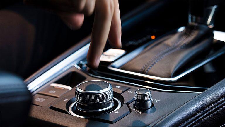 Someone adjusting the transmission settings inside a 2019 Mazda CX-5