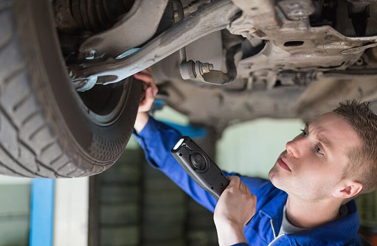 Mechanic inspecting tire_b