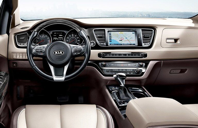 2017 Kia Sedona steering wheel and infotainment system