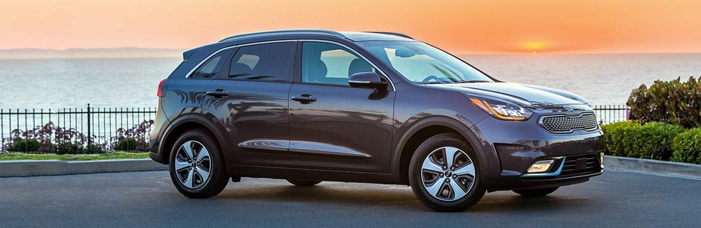 Passenger side exterior view of gray 2018 Kia Niro