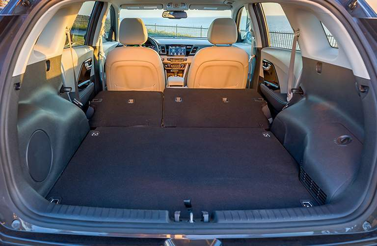 Rear seats folded flat for storage in the 2018 Kia Niro