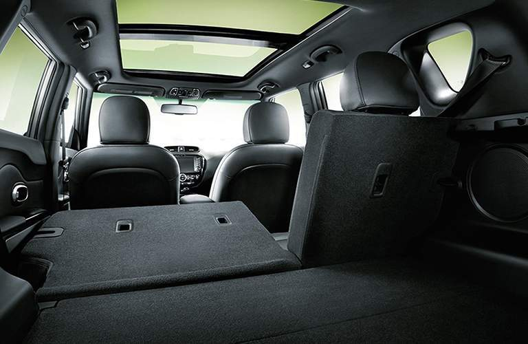 Rear seat half folded flat for storage in the 2018 Kia Soul