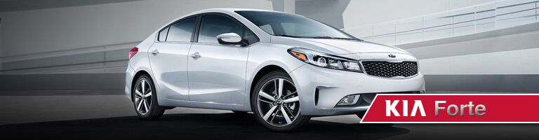 Front exterior view of a white Kia Forte