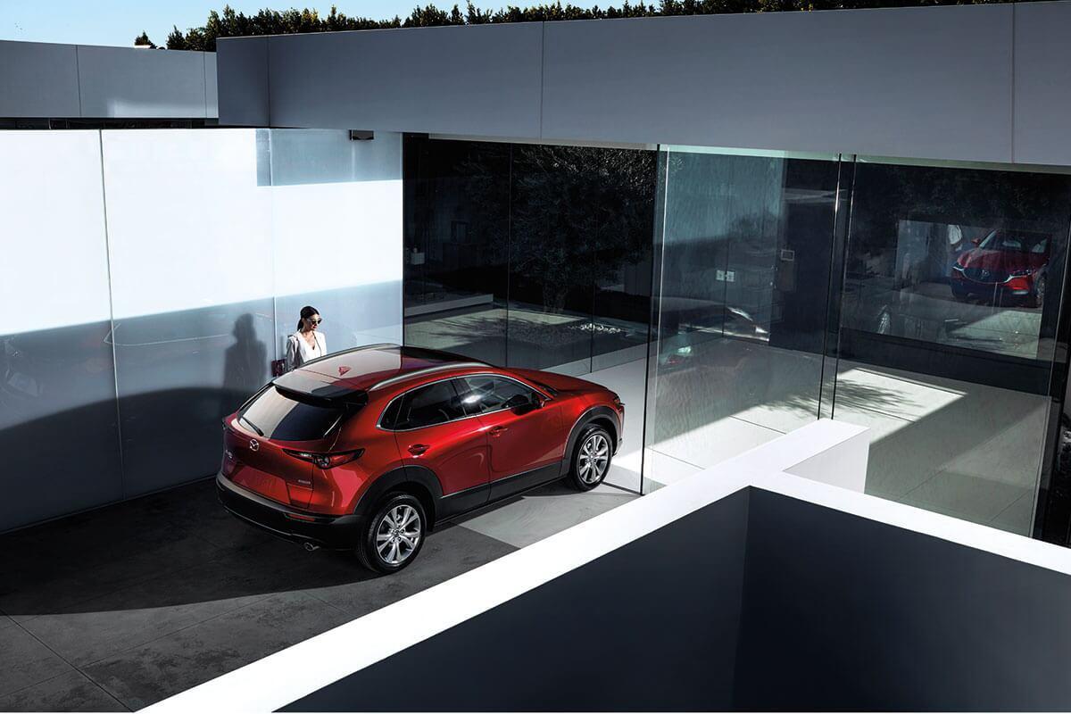 A Mazda CX-30 parked near a building in Corona, CA