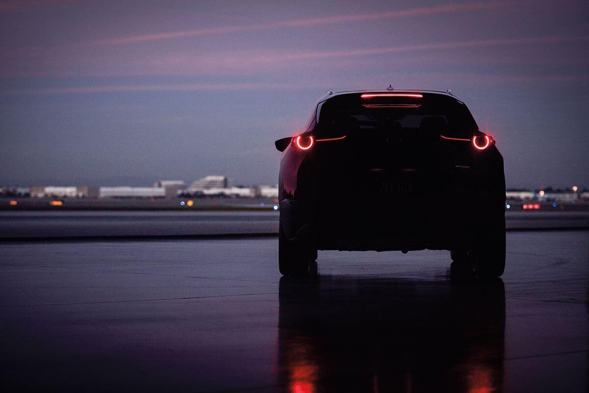 The tail-end of a Mazda CX-30 at dusk near Corona, CA