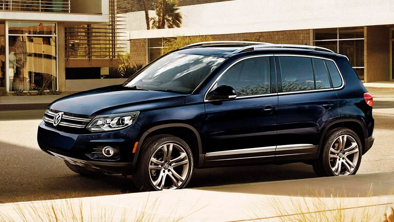 2016 Volkswagen Tiguan  in dark blue with silver roof rails