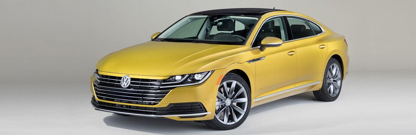 yellow 2019 Volkswagen Arteon in white room