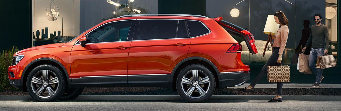 orange Volkswagen Tiguan side view