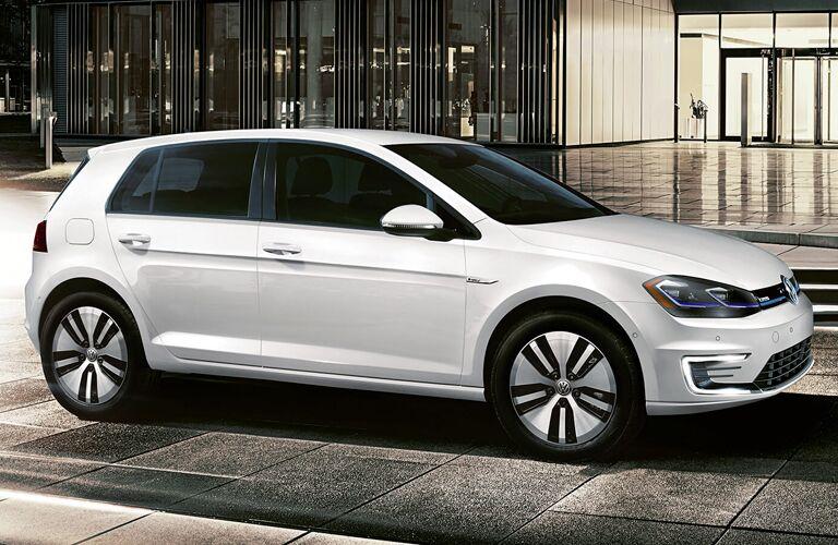 white 2019 Volkswagen e-Golf in a city