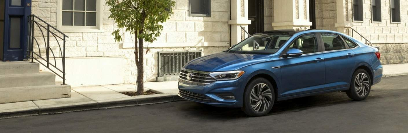2019 Volkswagen Jetta outside a city apartment building