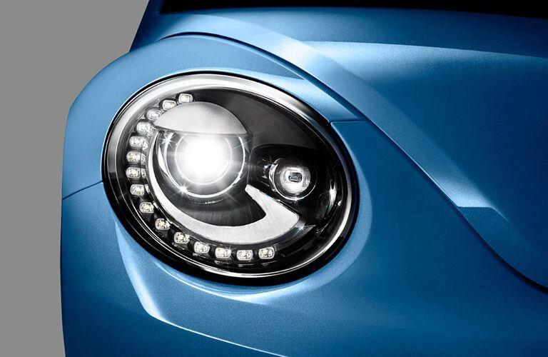 2018 VW Beetle super close up of blue headlight