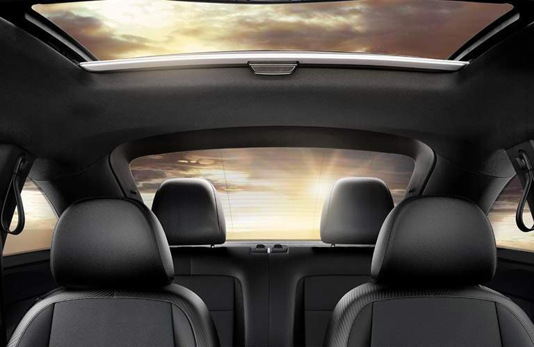 Interior view out the rear window and sun roof of the 2018 VW Beetle