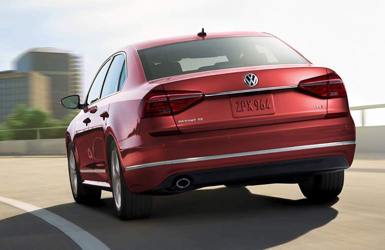 Rear exterior view of a red 2018 VW Passat