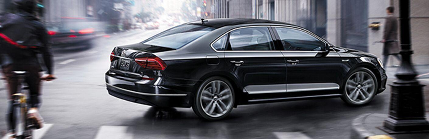 black 2019 Volkswagen Passat on rainy city street