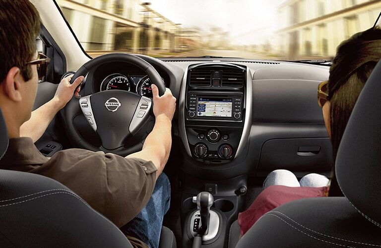 View of 2017 Nissan Versa Sedan front Seats in Black with Two People in Driver and Passenger Seat