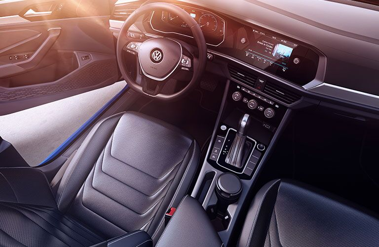 Driver seat and gear shifter of 2019 Volkswagen Jetta with steering wheel in view