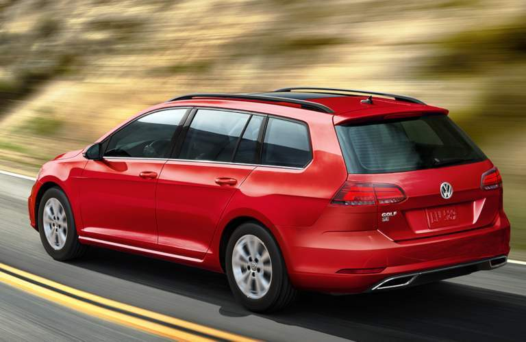 2019 Volkswagen Golf SportWagen driving down a mountain road