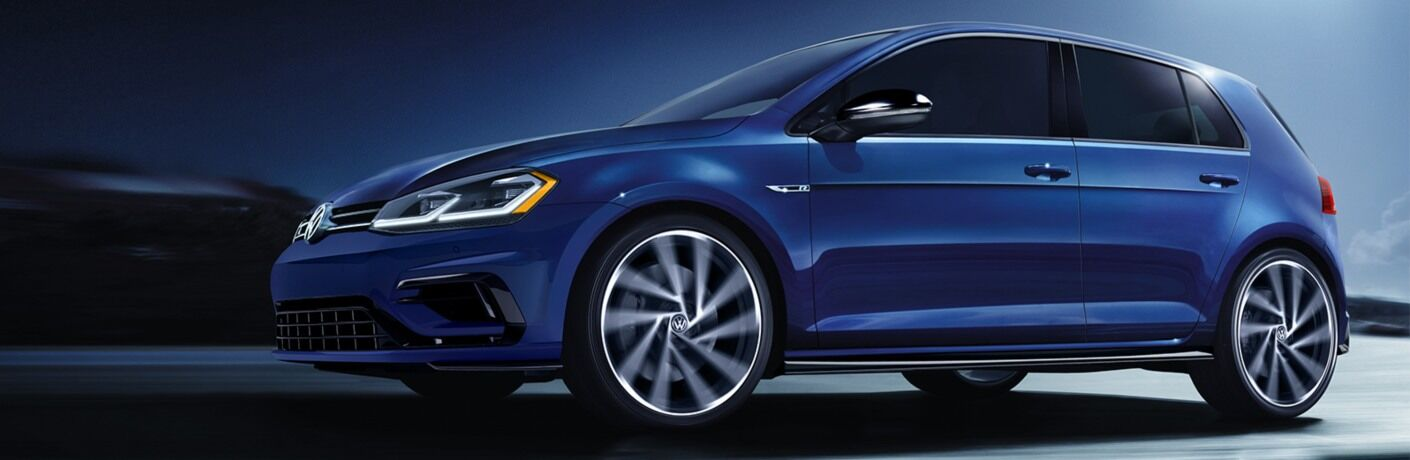 2019 Volkswagen Golf R driving down a dark road