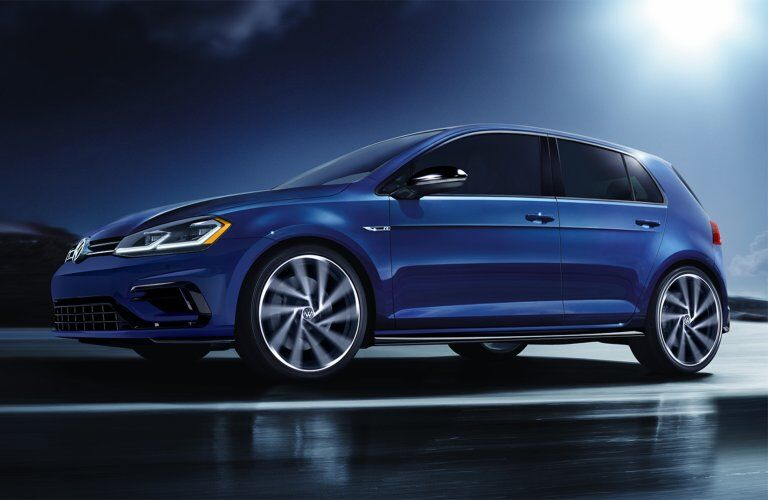 2019 Volkswagen Golf R driving down a road at night