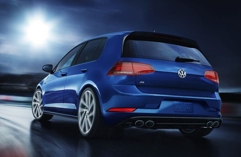 2019 Volkswagen Golf R driving down a winding road at night