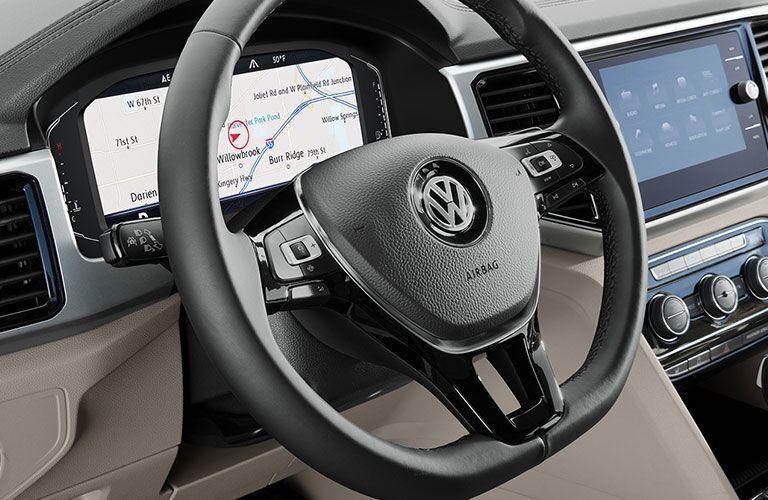 2020 Volkswagen Atlas close up of steering wheel and digital instrument cluster showing navigation