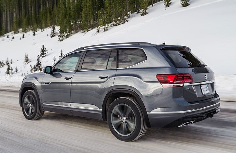 2020 Volkswagen Atlas side view driving through snowy mountain road