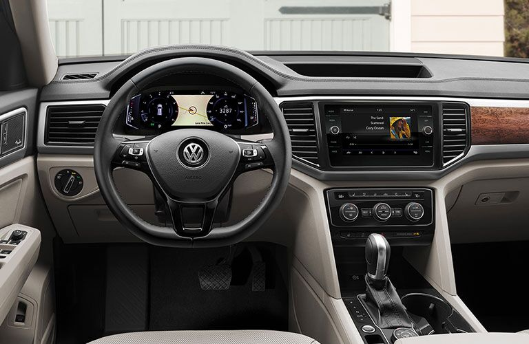 2020 Volkswagen Atlas interior view of driver side cabin with infotainment screen on