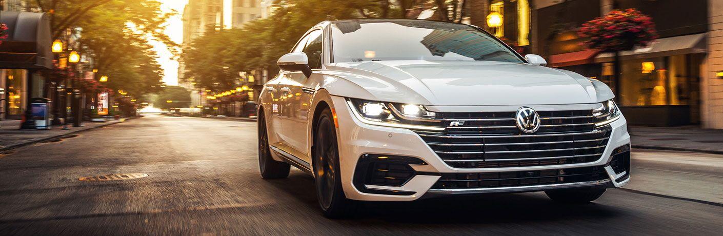 2020 Volkswagen Arteon white driving toward shot at golden hour