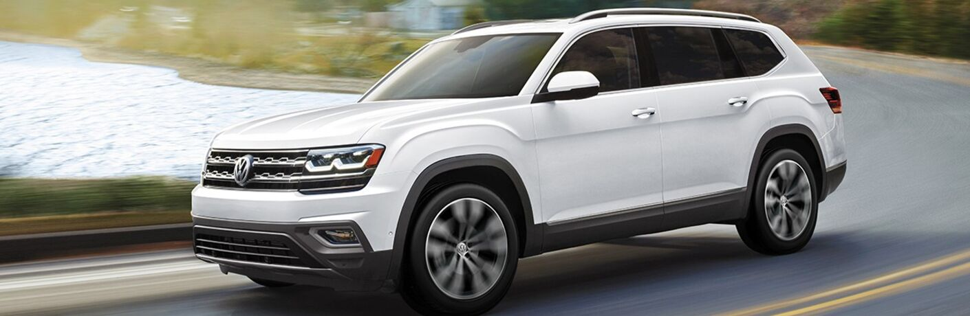 2020 Volkswagen Atlas white paint driving down road with white and green background