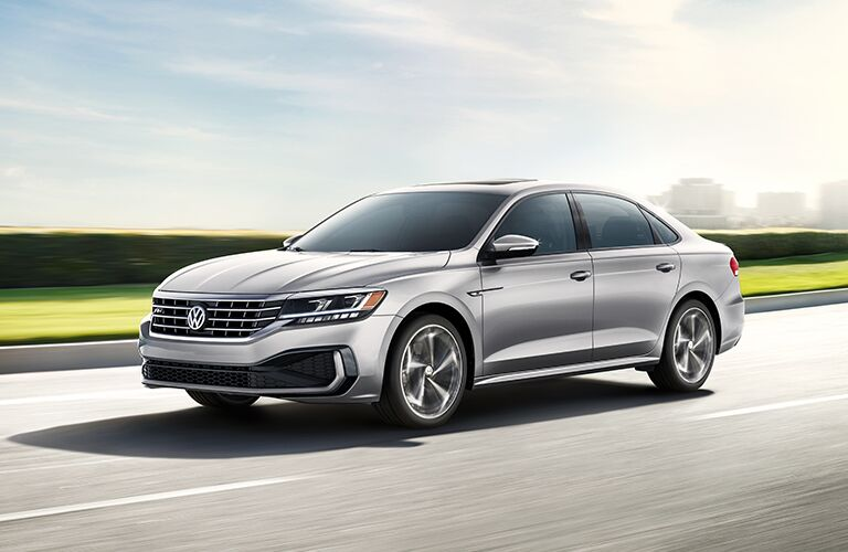2020 Volkswagen Passat silver driving down road with motion blur