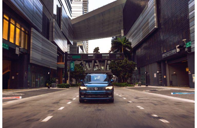2020 Volkswagen Tiguan blue far away driving directly toward shot on city street