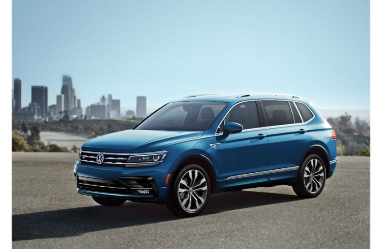 2020 Volkswagen Tiguan exterior blue parked with city in background