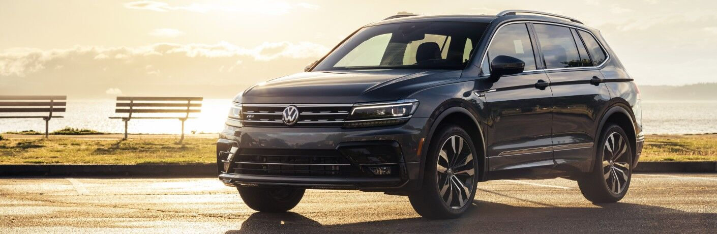 2020 Volkswagen Tiguan parked by water at sunset