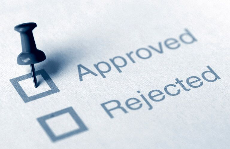 Financing Approved and Rejected Checklist with Pin in Approved Box