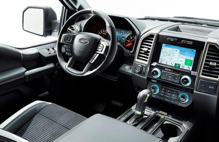 2017 Ford F-150 Raptor interior with steering wheel and dash