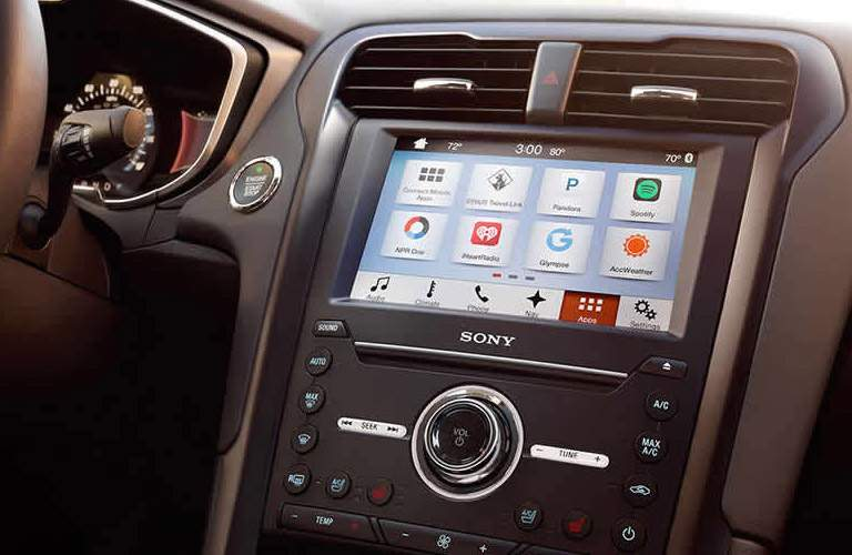 close up of the infotainment system and instrument panel of a 2018 Ford Fusion