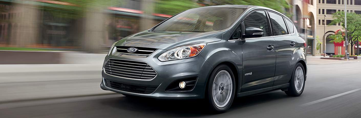 silver 2018 Ford C-MAX Hybrid driving down a city street