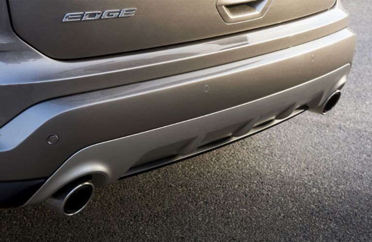 close up of the rear bumper and exhaust of a 2019 Ford Edge Titanium Elite