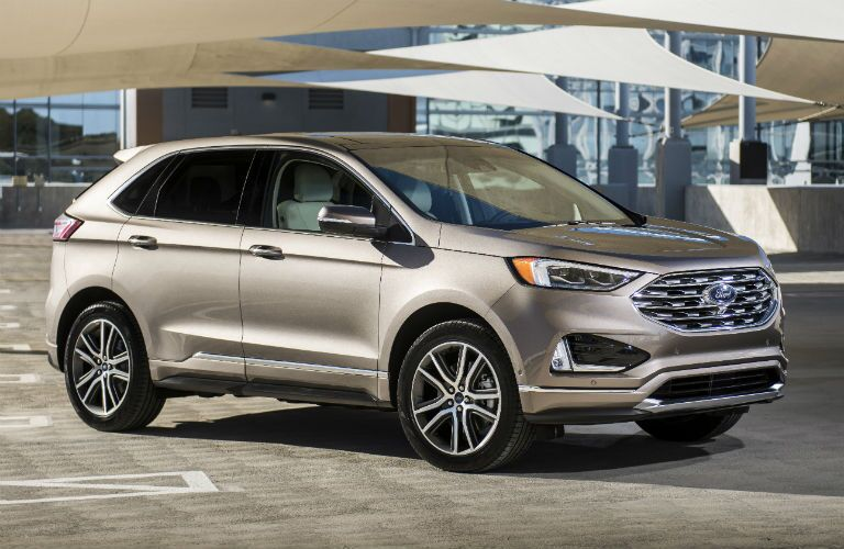 side view of a tan 2019 Ford Edge Titanium Elite