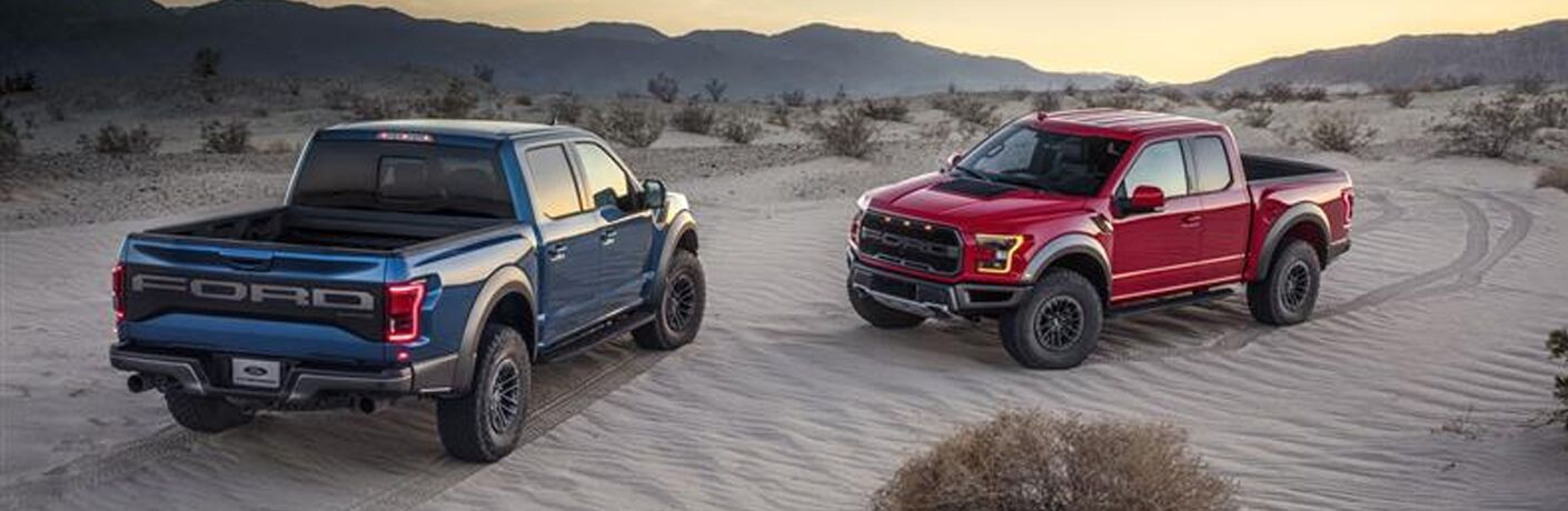 a blue 2019 Ford F-150 Raptor and a red 2019 Ford F-150 Raptor