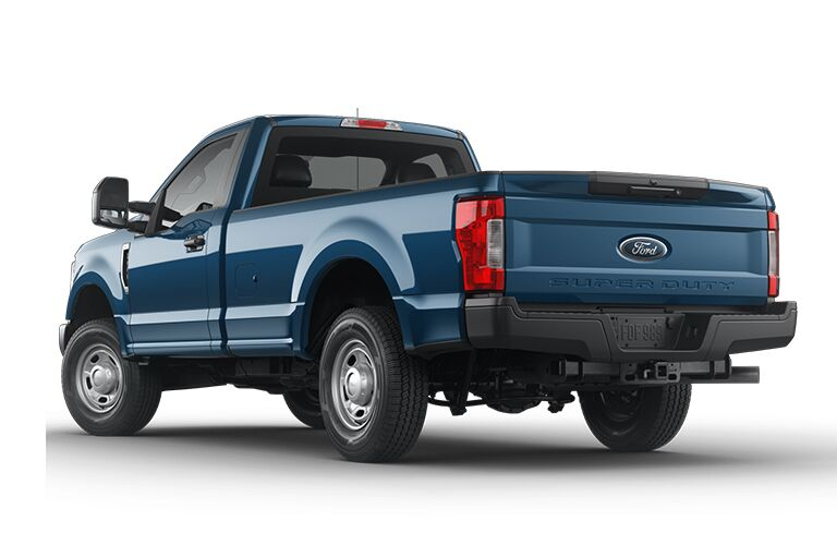 side view of a blue 2019 Ford F-350 Super Duty