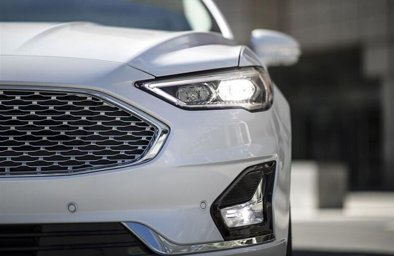 close up of the front exterior of a white 2019 Ford Fusion