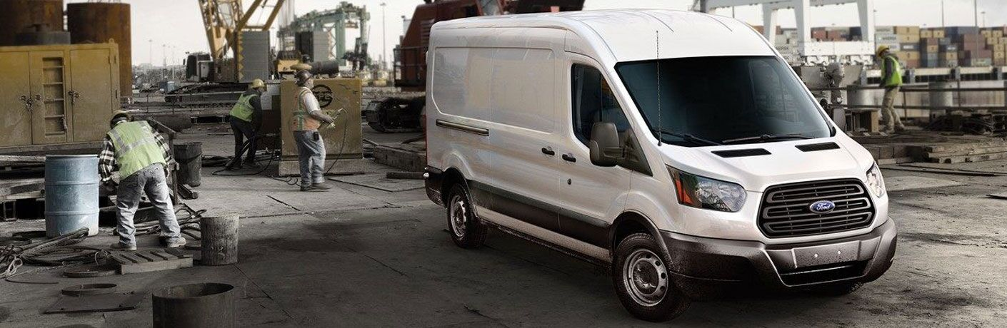 front view of a white 2019 Ford Transit Connect Cargo Van parked at a construction site