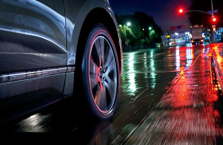 2020 Ford Edge ST wheel on rainy road