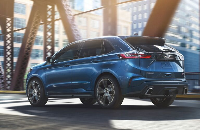 side view of a blue 2020 Ford Edge