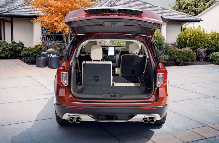 rear view of a red 2020 Ford Explorer with its cargo door open