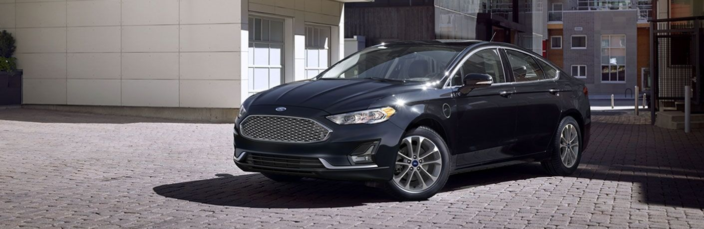side view of a black 2020 Ford Fusion Plug-In Hybrid