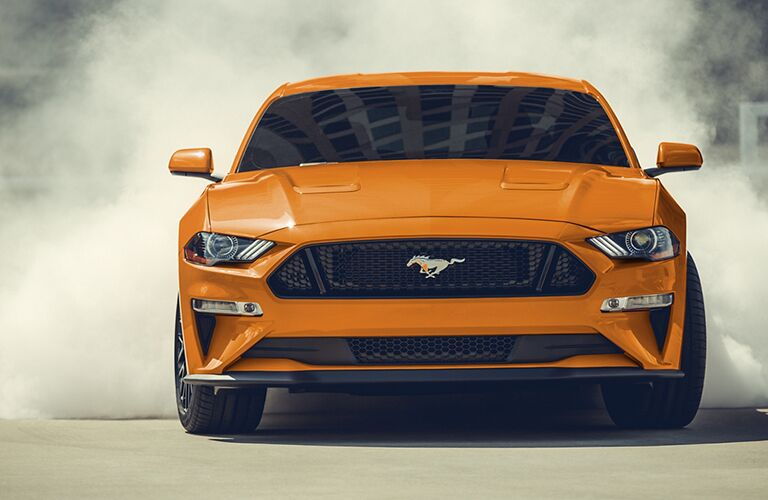 front view of an orange 2020 Ford Mustang