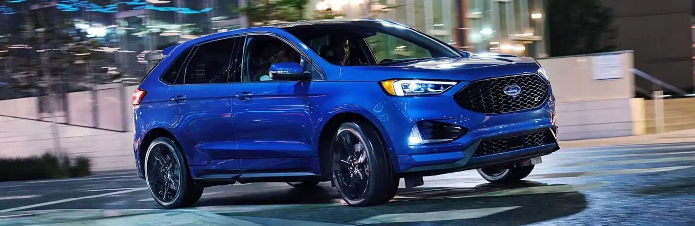 side view of a blue 2021 Ford Edge