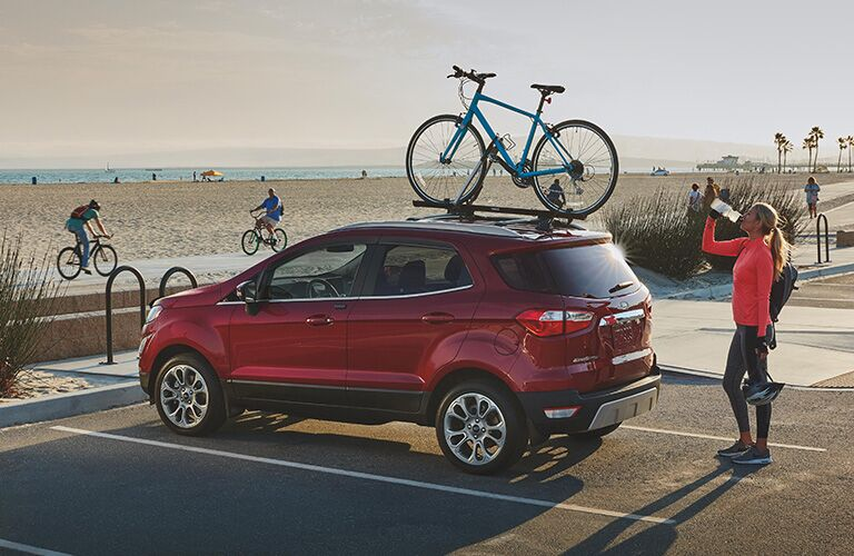 side view of a red 2021 Ford EcoSport with a bike on its roof rack